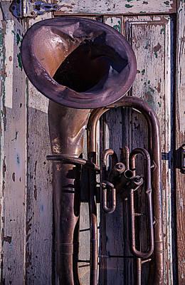 Beaten Up Photograph - Old Tuba On Worn Door by Garry Gay