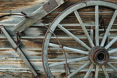 Old Wagon Wheel In Nevada City Montana Print by Bruce Gourley
