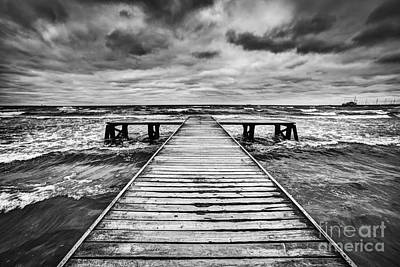 Old Wooden Jetty During Storm On The Sea Print by Michal Bednarek