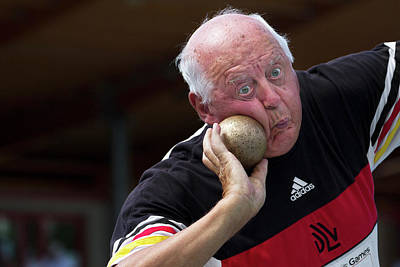 Gathered Photograph - Older Man About To Throw Shot Put by Alex Rotas