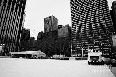 olympia zamboni ice clearer clearing the ice at Bryant Park ice skating rink new york city Print by Joe Fox