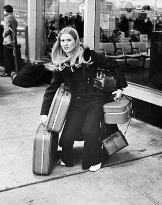 Blonde Hair Photograph - Overloaded Airline Traveler by Underwood Archives