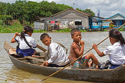 Floating Girl Photograph - Paddling Home From School by David Freuthal