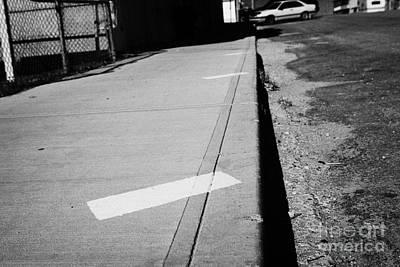 park diagonally markers on the sidewalk of main street hafford Saskatchewan Canada Print by Joe Fox