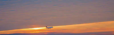 Passenger Airliner Landing At Dawn Print by Jim West