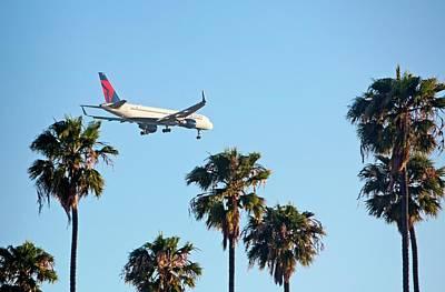 Aeronautics Photograph - Passenger Jet Airliner Landing by Jim West