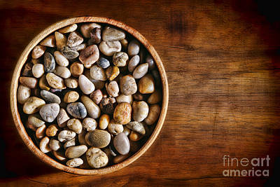 Pebbles In Wood Bowl Print by Olivier Le Queinec