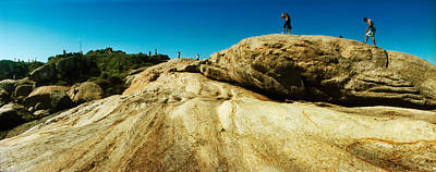 Ipanema Beach Photograph - People Hiking Along The Boulders That by Panoramic Images