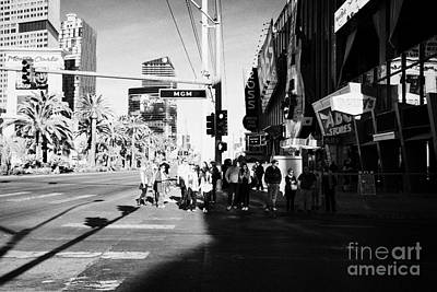 people waiting to cross at intersection on south Las Vegas boulevard strip Nevada USA Print by Joe Fox