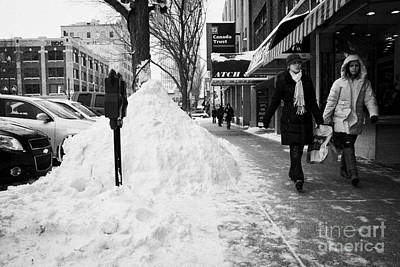 people walking along clear sidewalks in downtown city street Saskatoon Saskatchewan Canada Print by Joe Fox