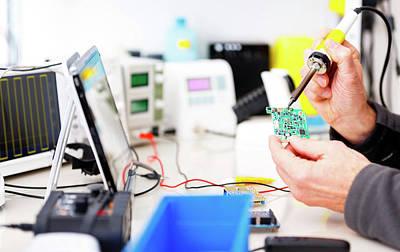 Person Repairing Electronic Circuit Board Print by Wladimir Bulgar