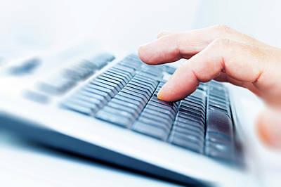 Keyboards Photograph - Person Using A Computer Keyboard by Wladimir Bulgar