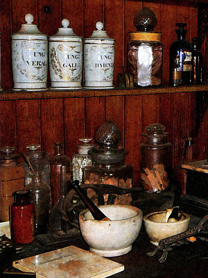 Glass Bottle Photograph - Pharmacist - Mortar And Pestles In Drug Store by Susan Savad