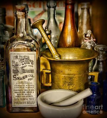 Brass Snake Photograph - Pharmacy - Snake Oil -dr. Jake Dawson by Paul Ward