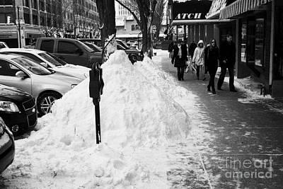 piles of snow cleared from downtown city street sidewalks Saskatoon Saskatchewan Canada Print by Joe Fox