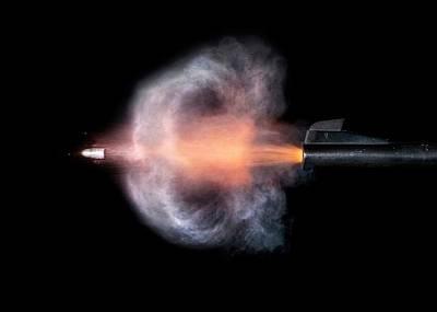 High Speed Photograph - Pistol Shot by Herra Kuulapaa � Precires