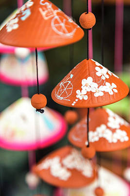 Pottery Wind Chimes With Vietnamese Print by Peter Adams