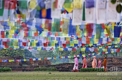 Prayer Flags And Novice Monks At Lumbini In Nepal Print by Robert Preston