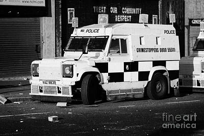 Psni Armoured Land Rover On Crumlin Road At Ardoyne Shops Belfast 12th July Print by Joe Fox