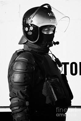 Psni Officer In Ninja Riot Geat On Crumlin Road At Ardoyne Shops Belfast 12th July Print by Joe Fox