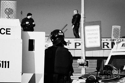 Psni Officers In Protective Riot Gear At Landrovers And Snipers On Crumlin Road At Ardoyne Shops Bel Print by Joe Fox