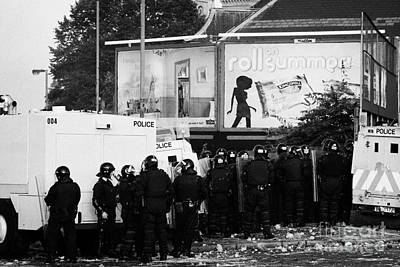 Psni Riot Officers Behind Armoured Land Rover Water Cannon Beneath On Crumlin Road At Ardoyne Shops  Print by Joe Fox