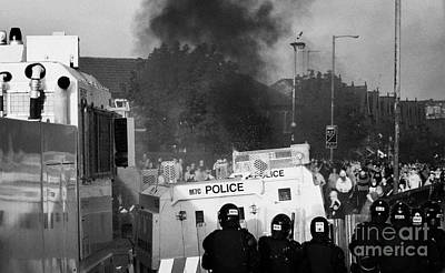 Psni Riot Officers Face Rioters Mob And Burning Vehicle On Crumlin Road At Ardoyne Shops Belfast 12t Print by Joe Fox