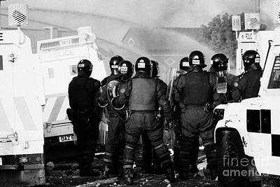 Psni Riot Officers Watch Rioting And Water Canon On Crumlin Road At Ardoyne Shops Belfast 12th July Print by Joe Fox