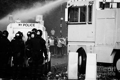 Psni Riot Police Behind Armoured Land Rover And Water Canon Face On Crumlin Road At Ardoyne Print by Joe Fox