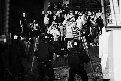 Psni Riot Police Face Angry Mob Of Rioters On Crumlin Road At Ardoyne Shops Belfast 12th July Print by Joe Fox