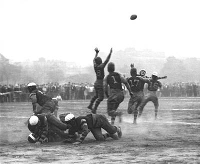 Football Photograph - Quarterback Throwing Football by Underwood Archives