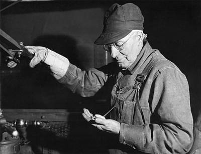 1910s Photograph - Railroad Engineer Checks Watch by Underwood Archives