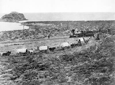 Wagon Train Photograph - Railroad Meets Wagon Train by Underwood Archives