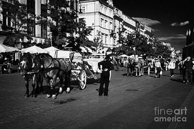 Polish City Photograph - Rank Queue Of Tourist Horse Drawn Carriages In Rynek Glowny Old Town Square Stare Miasto Krakow by Joe Fox