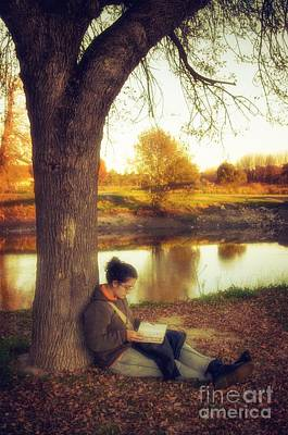 Thoughtful Photograph - Reading Under The Tree by Carlos Caetano