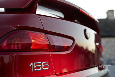 Braking Photograph - rear logo and brake lights on an Alfa Romeo 156 by Joe Fox