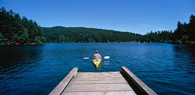 Getting Away From It All Photograph - Rear View Of A Man On A Kayak by Panoramic Images
