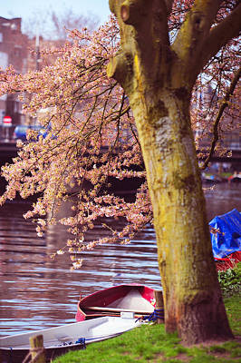 Red Canoe. Amsterdam Canals With Blooming Trees. Pink Spring In Amsterdam Print by Jenny Rainbow