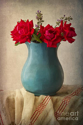 Red Roses In A Blue Pot Print by Elena Nosyreva