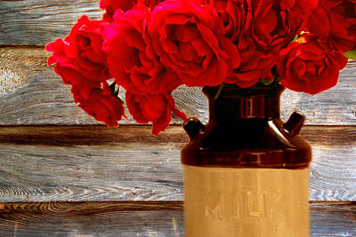 Old Milk Jugs Photograph - Red Roses In A Vintage Milk Jug by Peggy Collins