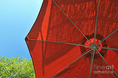 Reddish Umbrella Against Blue Sky Print by Sami Sarkis
