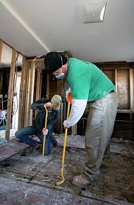 Reliefs Photograph - Repairing Hurricane Sandy Damage by Jim West