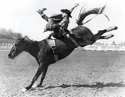 1950 Photograph - Riding A Bucking Bronco by Underwood Archives