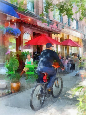 Child Photograph - Riding Past The Cafe by Susan Savad
