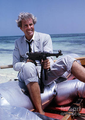 Rik Van Nutter On A Raft On The Set Of Thunderball Print by The Phillip Harrington Collection