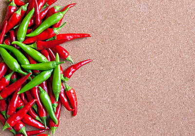Chillie Photograph - Ripe Red And Green Chillies On Cork Board by Ken Biggs