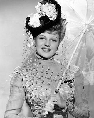 Rita Hayworth Under Umbrella Print by Retro Images Archive