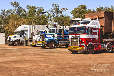 Road Trains Taking On Gas Or Diesel Print by Colin and Linda McKie