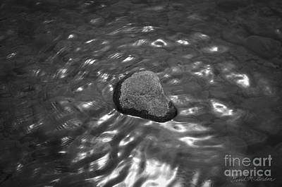 Rock And Sun Reflections Print by Dave Gordon