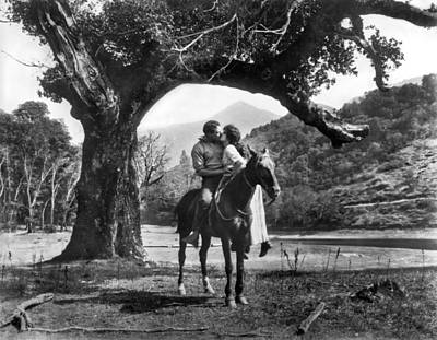 Romantic Kiss On Horseback Print by Underwood Archives